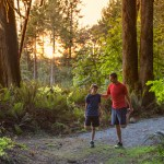 father and son stretching on trail run