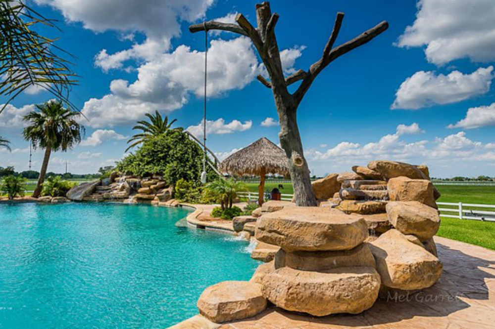 june2015 trulia 9 homes for sale with epic water slides el campo - Cool Pools With Waterfalls In Houses