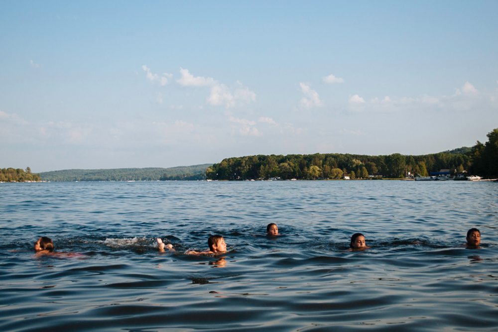 Kids Swimming In A Lake real estate lessons you (unknowingly) learned at summer camp