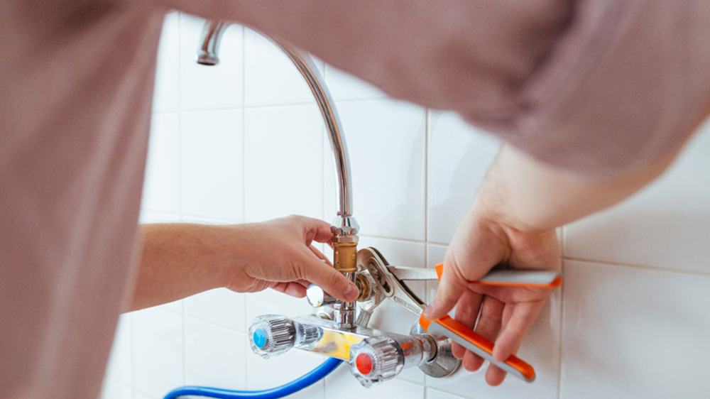 home maintenance man fixing sink