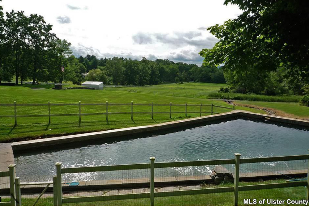 Homes for sale with pools and porches for summertime for Homes with inground pools for sale near me